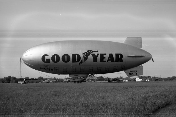 The Goodyear Ranger II (NC-1A) blimp docked to it's mobile station on June 13, 1947 at Buffalo Airpark. The Quonset hangar and operations building is seen in the background.