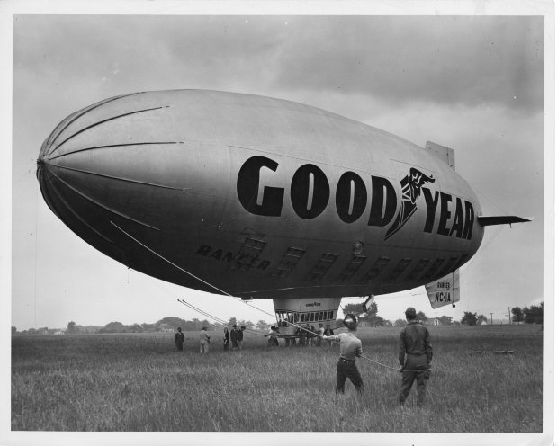 The Goodyear Ranger II (NC-1A) blimp being controlled by a group of unknown people at Buffalo Airpark on June 13, 1947. Tony Riccio and his wife Maxine can be seen under the blimp to the left of the cabin car.