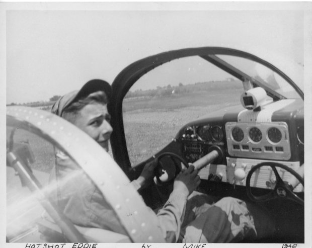 """A person known as """"Hot Shot Eddie"""" is sitting in the pilot's seat of a Globe Swift airplane at Buffalo Airpark dated 1946."""