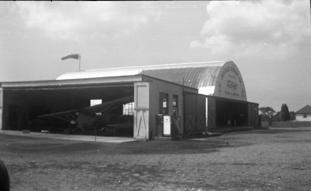 The Maintenance shop at Buffalo Airpark with the Quonset hangar in the background.