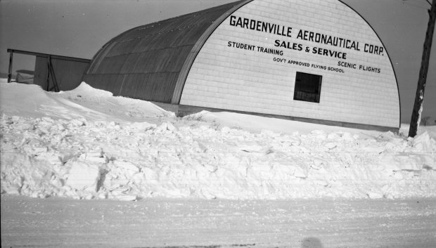 The Quonset hangar at the Garden Airport, aka Gardenville Aeronautical Corp., as viewed from Clinton Street during the winter season.