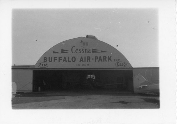 The Quonset hangar at Buffalo Airpark with a newly painted Cessna logo.