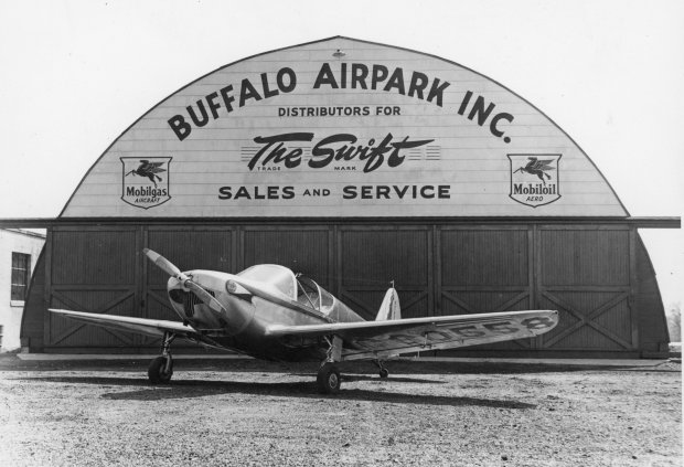 A Globe Swift parked in front of the Quonset hangar at Buffalo Airpark.