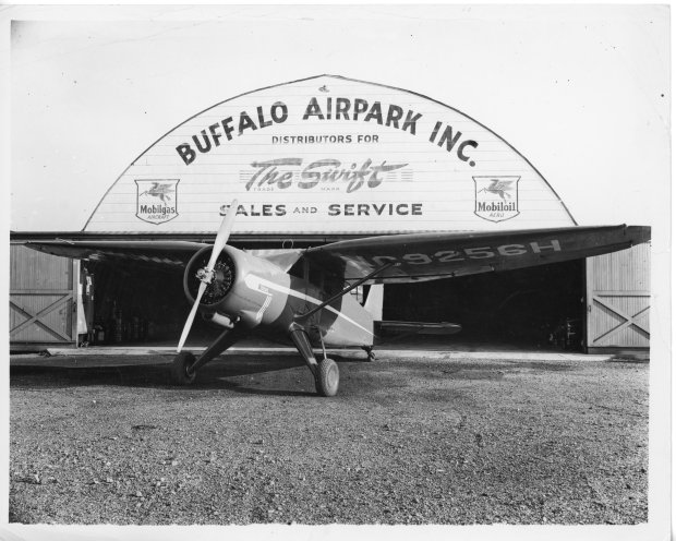 A 1946 Stinson Vultee V-77 parked in front of the Quonset hangar at Buffalo Airpark.