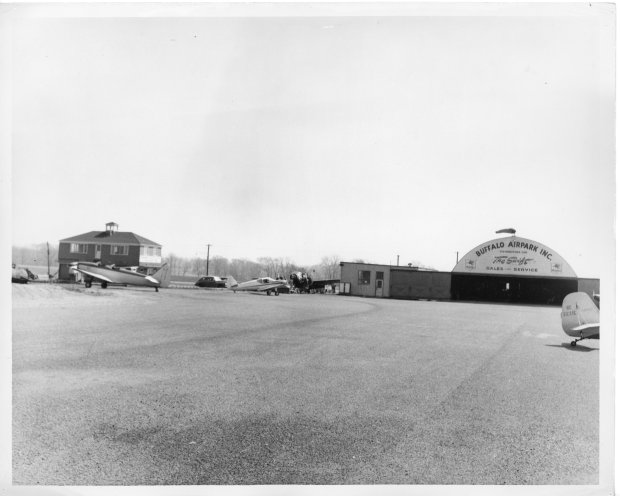 Standing on the tarmac at Buffalo Airpark and looking towards the Quonset hangar and Operations building.