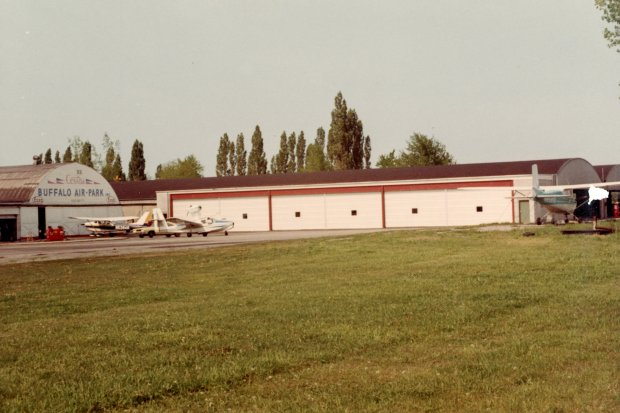 The twin hangars with the addition of three hangar bays at Buffalo Airpark.