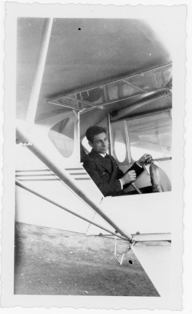 "Tony Riccio sitting in the pilot's seat of his J-3 ""Cub""."