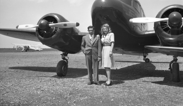 Tony Riccio and his wife Maxine standing in front of a Cessna T-50 twin engine airplane.