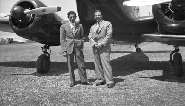 Tony Riccio and an unknown person standing in front of a Cessna T-50.