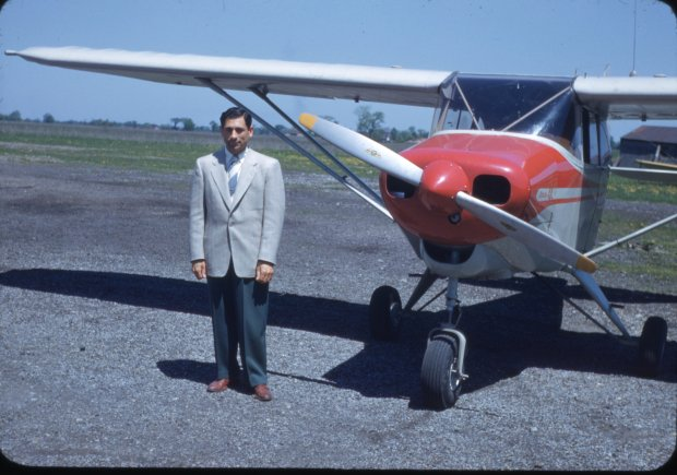 Tony Riccio standing on the right side of a Piper Pacer 125 airplane at Buffalo Airpark.