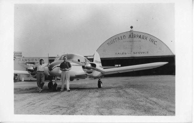 "Tony Riccio and an unknown person standing if front of a Piper PA-23 ""Apache"" twin engine airplane at Buffalo Airpark on September 5, 1954."