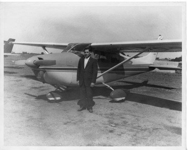 Tony Riccio standing next to a Cessna Skylane.