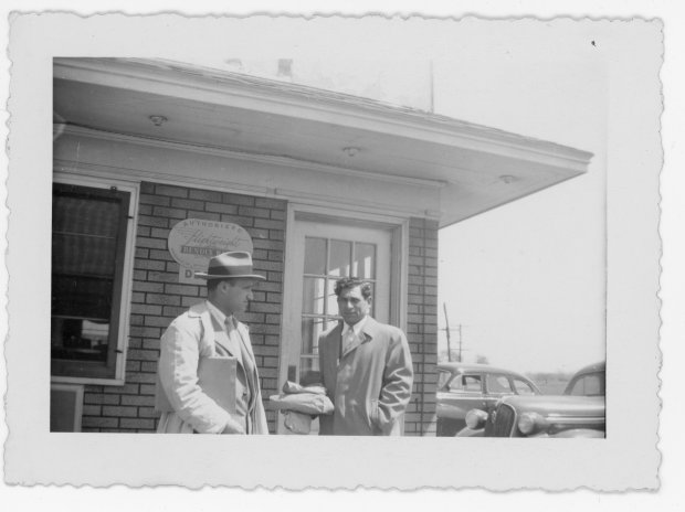Tony Riccio and an unknown person standing outside of the Gardenville Airport operations building.