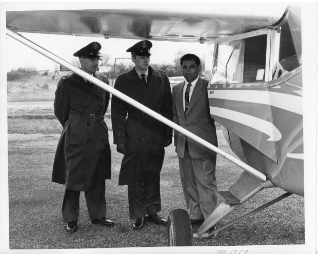 Tony Riccio and two unknown people standing next to an airplane at Buffalo Airpark in December 1958.