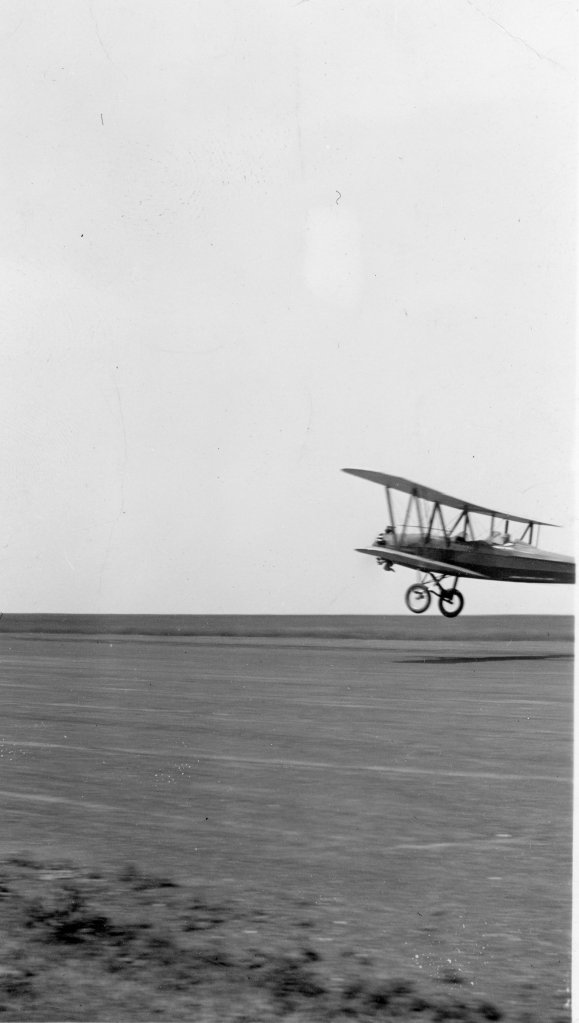Tony Riccio piloting an Alexander Eaglerock, A-15, on takeoff.