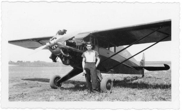 Tony Riccio standing in front of his Aristocrat 102-E airplane.