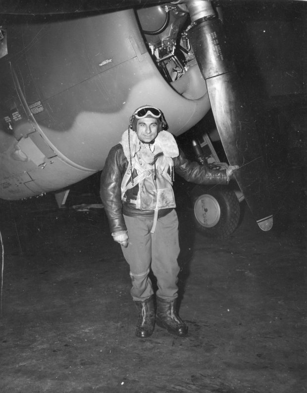 Tony standing in front of a P-47 in full flight gear!