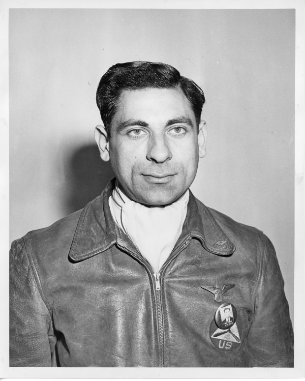 Tony Riccio wearing a leather flight jacket with his Republic photo identification pin.