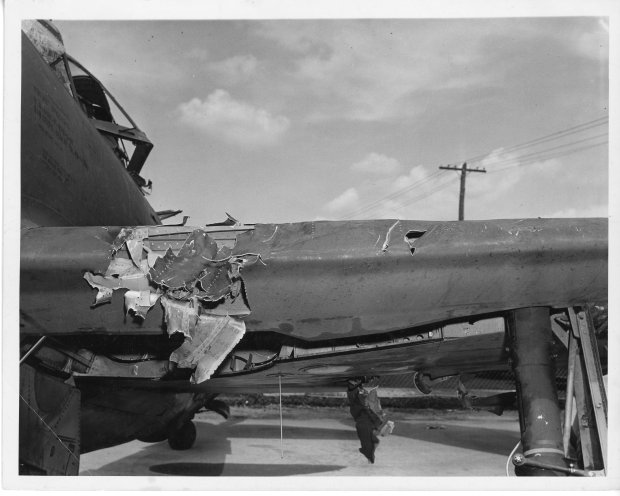 Damage to Tony's P-47 left wing's leading edge near the fuselage.